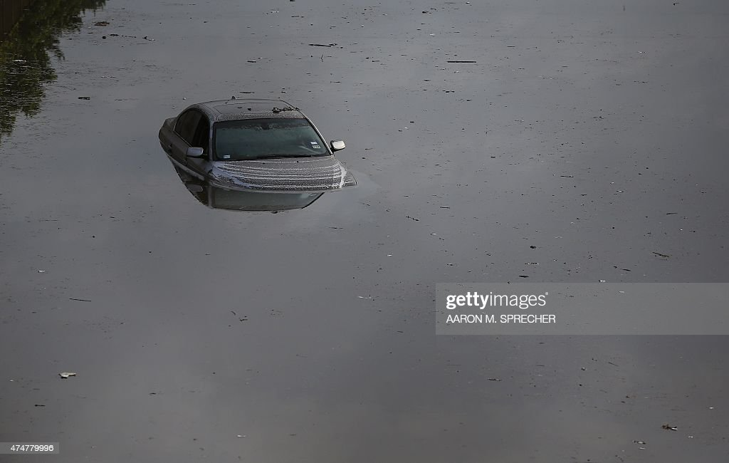 A vehicle left stranded on a flooded Interstate 45 in Houston Texas on May 26 2015 Heavy rains throught Texas put the city of Houston under massive...