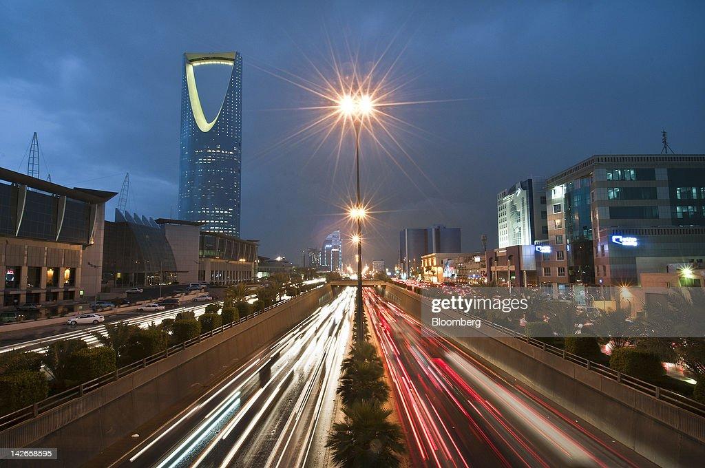 Vehicle light trails pass the Kingdom Tower on King Fahad Road in Riyadh Saudi Arabia on Monday April 9 2012 Saudi Arabia's gross domestic product...