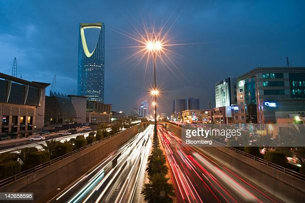 Vehicle light trails pass the Kingdom Tower on King Fahad Road in Riyadh Saudi Arabia on Monday April 9 2012 Saudi Arabia's gross domestic product...