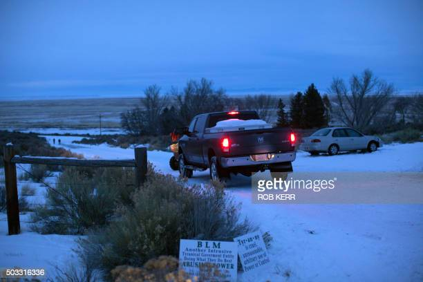 A vehicle occupied by members of a small militia group enter the Malheur Wildlife Refuge Headquarters property some 30 miles from Burns Oregon...