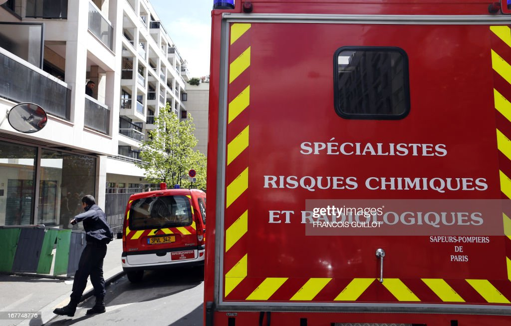 A vehicle of firefighters specialized in chemical and radiological risks is parked outside the premises of the 'Syndicat de la magistrature' (Magistrates union) on April 29, 2013 in Paris, after the union received an envelope containing suspect white powder which happens to be food powder according to first police tests.