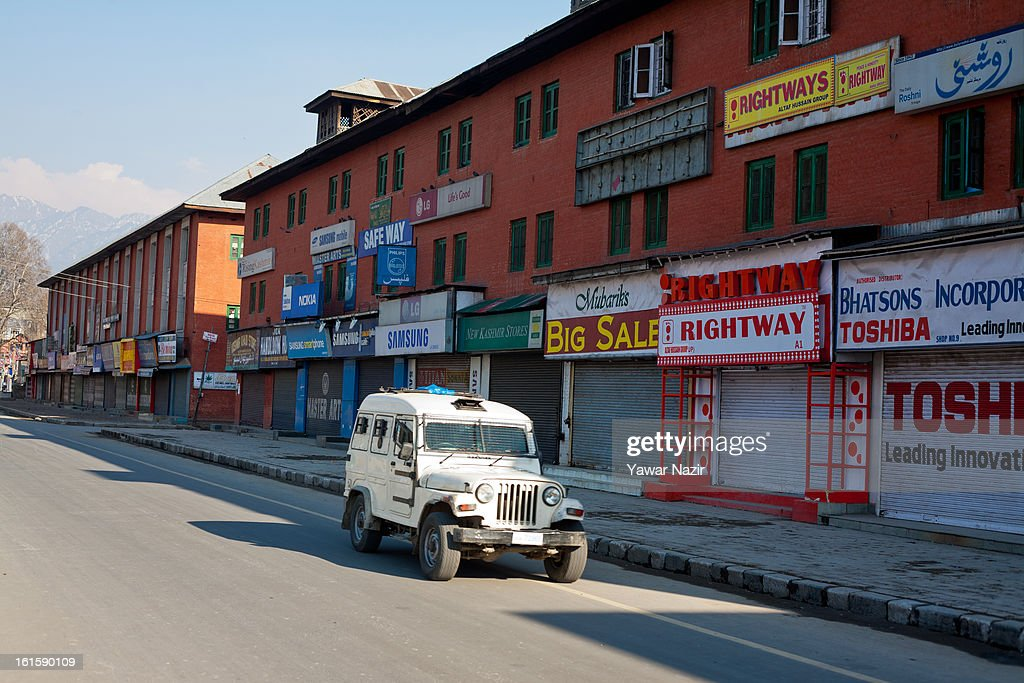 Vehicle of Indian police patrols a deserted streets of City Centre during a curfew, imposed after the execution of alleged Indian parliament attacker Mohammad Afzal Guru on February 12, 2013 in Srinagar, the summer capital of Indian Administered Kashmir, India. Afzal Guru, from Sopore town in the north of Kashmir, was hung on February 09 for his role in the 2001 Indian parliament attack which left 14 dead. The hanging has further strained relations between India - who blamed the attack on 'Pakistan backed' militant group Jaish-e-Mohammed - and neighbouring Pakistan and has seen an military increase from both along the border.