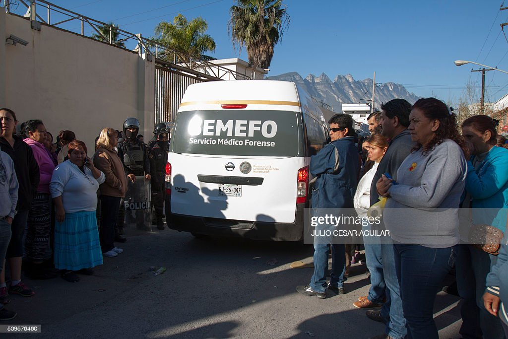 A vehicle of the forensic service arrives at the Topo Chico prison in the northern city of Monterrey in Mexico where according to Nuevo Leon State governor at least 52 people died and 12 were injured in a prison riot on February 11, 2016. At least 52 inmates died in a Mexican prison on Thursday as prisoners ignited a fire during a brawl between two rival groups, authorities said. Governor Jaime Rodriguez said the clash erupted at the Topo Chico prison in the northern industrial city of Monterrey before midnight on Wednesday and that authorities brought it under control at 1:30 am on Thursday. AFP PHOTO / JULIO CESAR AGUILAR / AFP / Julio Cesar Aguilar
