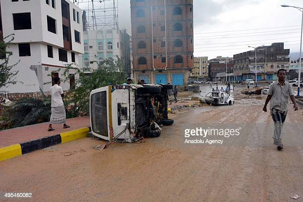 Vehicle overturning at a flooded road is seen after being swept away in wind and heavy raincaused floodwaters as a result of Cyclone Chapala...