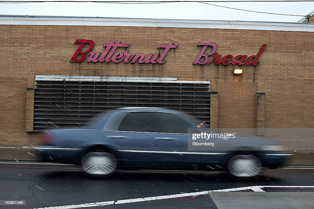 A vehicle passes an idled Hostess Brands Inc. bakery in Peoria, Illinois, U.S., on Wednesday, Feb. 27, 2013. Flowers Foods Inc., maker of packaged bakery foods, won the bidding for the majority of the bread-making business of Hostess Brands Inc., including the Wonder, Butternut, Home Pride, Merita and Nature's Pride brands, 20 bread plants, 38 depots and other assets, after no other competing offers were submitted. Photographer: Daniel Acker/Bloomberg via Getty Images