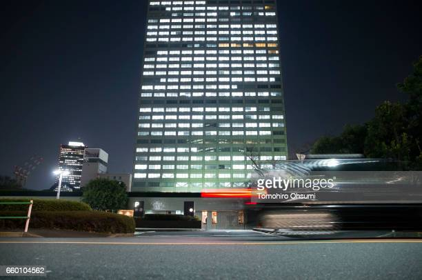 A vehicle passes the Toshiba Corp headquarters at night on March 29 2017 in Tokyo Japan Toshiba announced that its US nuclear unit Westinghouse...