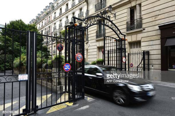 A vehicle passes through gates near the home of French actress Jeanne Moreau in Paris on July 31 after her death at the age of 89 was announced...