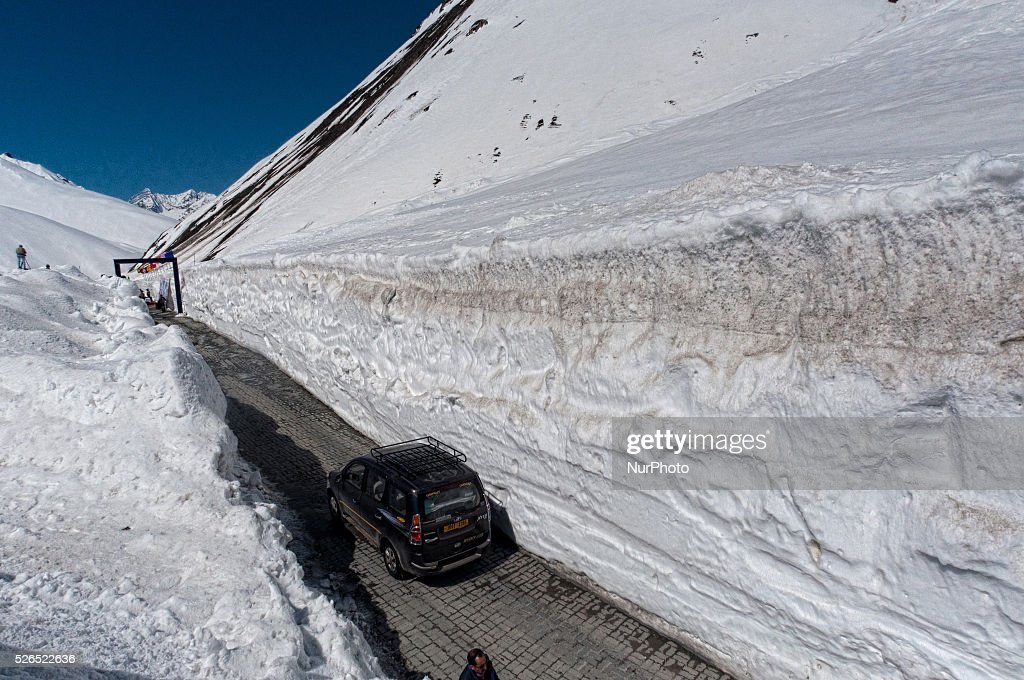 A vehicle passes through the snow cleared Srinagar-Leh highway in Zojila, 108 km (67 miles) east of Srinagar, the summer capital of Indian controlled Kashmir, India. on April 30, 2016. The 443 km (275 mile) long highway was opened for the season by Indian Army authorities after the remaining snow at Zojila Pass, some 3,530 metres (11,581 feet) above sea level, had been cleared. The pass connects Kashmir with the Buddhist-dominated Ladakh region, a famous tourist destination known for its monasteries, landscapes and mountains.