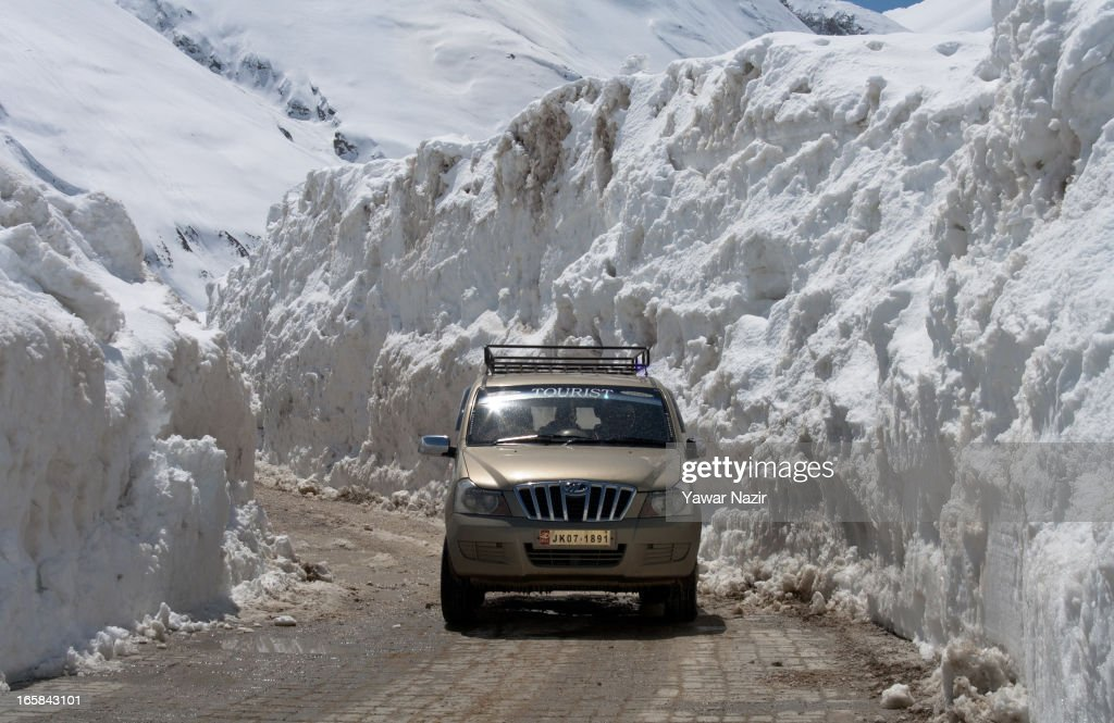 A vehicle passes through the snow-cleared Srinagar-Leh highway after it was reopen by authorities on April 06, 2013 in Zojila, 108 km (67 miles) east of Srinagar, the summer capital of Indian administered Kashmir, India. The 443 km (275 miles) long Srinagar-Leh highway was opened for vehicular traffic by Indian Border Roads Organisation after remaining snowbound at Zojila Pass for the past six months. The pass connects Kashmir with Ladakh region a famous tourist destination among foreign tourists for its monasteries, landscapes and mountains.