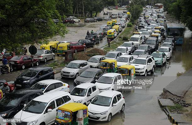 Vehicle plying in rain water at expressway service lane near Signature Tower Chowk on August 9 2015 in Gurgaon India Heavy rains caused major...