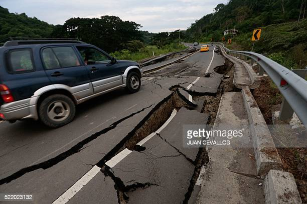 A vehicle rolls on a cracked route after a 78magnitude quake in Chone Ecuador on April 17 2016 At least 246 people were killed when a powerful...