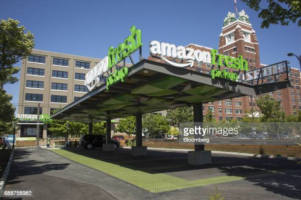 A vehicle sits at an AmazonFresh Pickup location next to the Starbucks Corp headquarters building in Seattle Washington US on Friday May 26 2017...
