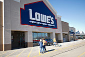 A vehicle sits outside a Lowe's store in East Peoria Illinois US on Wednesday Feb 20 2013 Lowe's Cos the secondlargest US homeimprovement retailer is...