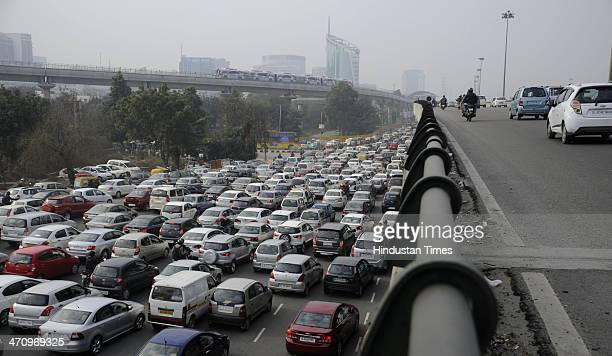 Vehicle stuck in heavy traffic after cross the Gurgaon Delhi expressway on the second day after toll was removed on February 21 2014 in Gurgaon India...