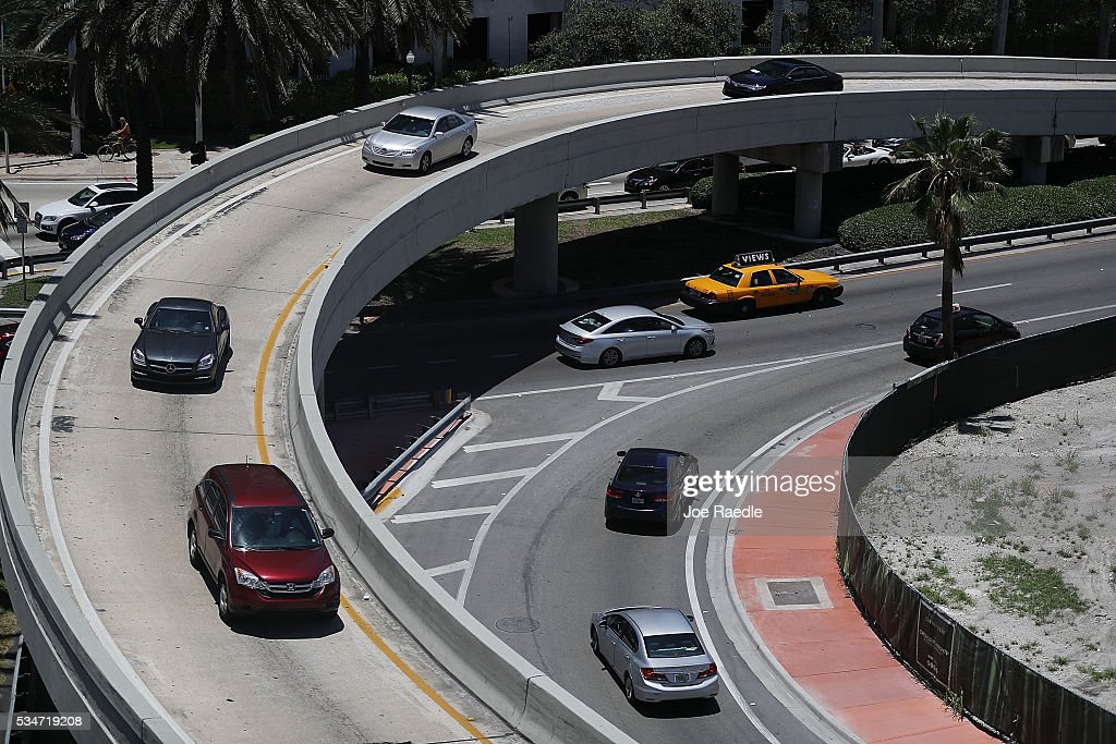 Vehicle traffic is seen in the street as people prepare for the Memorial Day weekend on May 27, 2016 in Miami Beach, Florida. AAA is predicting 34 million Americans will drive 50 miles or more for Memorial Day weekend, the most since 2005.