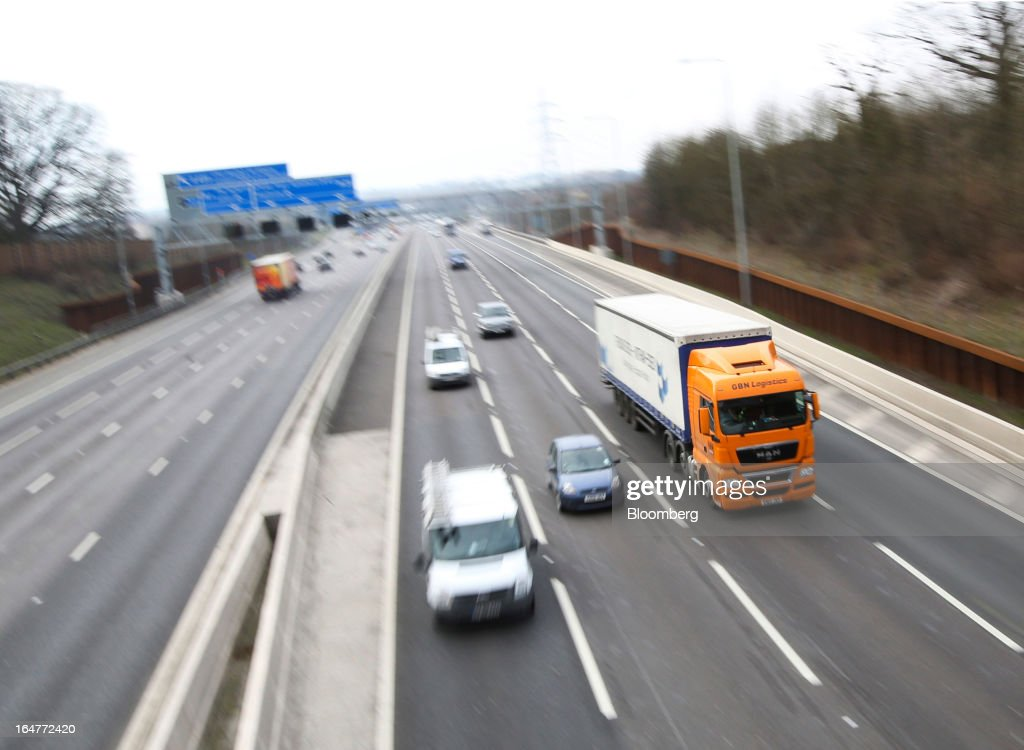 Vehicle traffic is seen moving in both directions along the northern section of the M25 motorway near London, U.K., on Wednesday, March 27, 2013. The U.K. government will increase spending on infrastructure projects, including road construction, by an annual 3 billion pounds ($4.6 billion) from 2015 as Chancellor George Osborne seeks to boost economic growth. Photographer: Chris Ratcliffe/Bloomberg via Getty Images