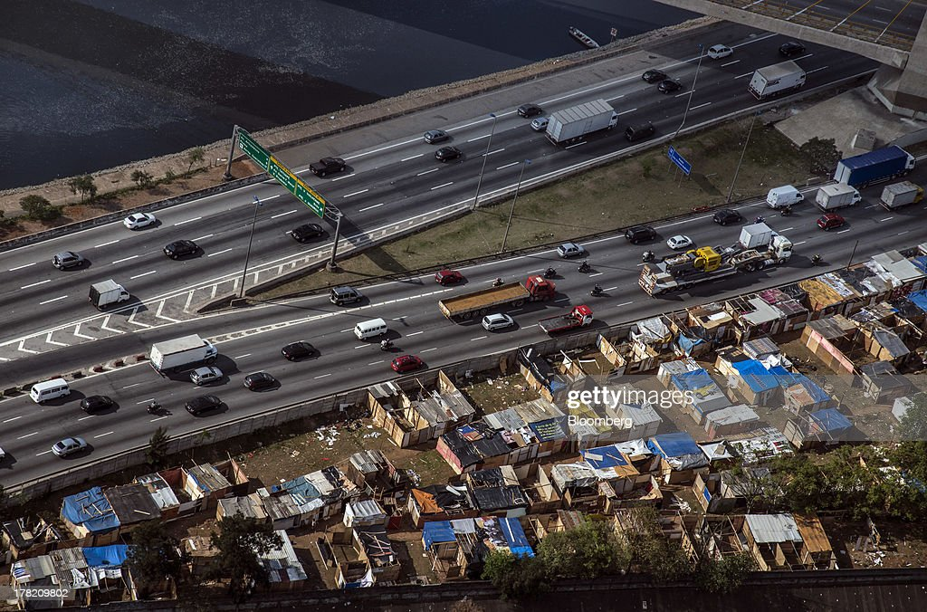 Vehicle traffic moves along the Marginal Tiete highway near the Tiete River in this aerial photo taken in Sao Paulo, Brazil, on Friday, Aug. 23, 2013. Home sales in Sao Paulo, Brazils biggest real-estate market, rose 46 percent in January through June from a year earlier, while housing starts climbed 51 percent, according to Embraesp, a property research group, and Secovi, a real-estate agency association. Photographer: Paulo Fridman/Bloomberg via Getty Images
