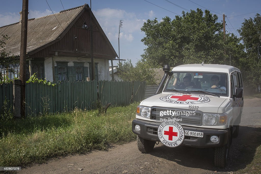 A vehicle transporting observers from the International Committee of the Red Cross visit the main crash site of Malaysia Airlines flight MH17 on July...