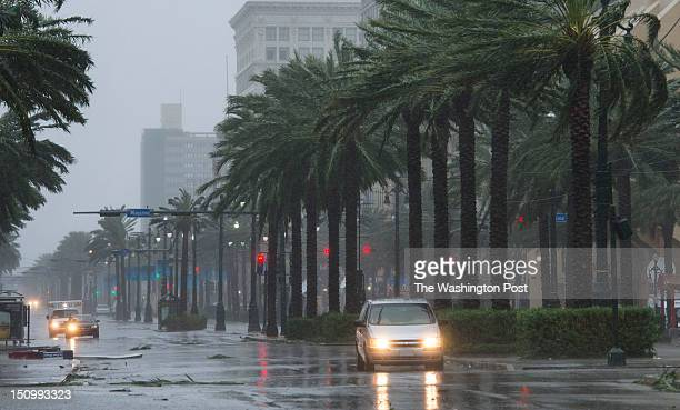 A vehicle travels down Canal Street as Hurricane Isaac dumps heavy rain on August 29 2012 in New Orleans La