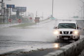 A vehicle travels through a a stretch of Interstate 10 flooded by Hurricane Ike September 13 2008 near Houston Texas Ike made landfall near Galveston...