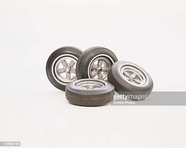 Vehicle tyres on white background