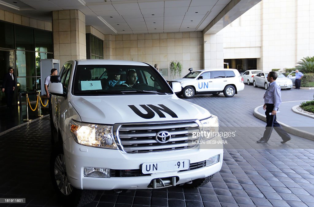 A UN vehicle, with Chief expert Ake Sellstrom on board, leaves an hotel in the Syrian capital Damascus on September 26, 2013. The experts arrived in Syria on September 25 on their second mission to the country, where they will examine some 14 alleged incidents involving the use of chemical weapons.