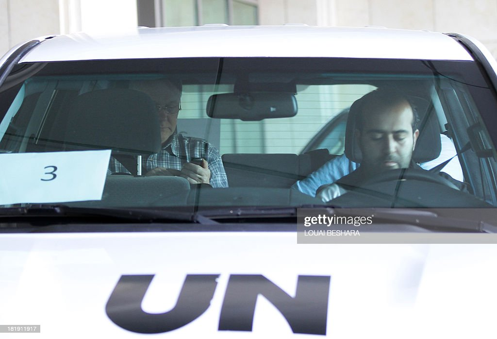 A UN vehicle, with Chief expert Ake Sellstrom (L) on board, leaves an hotel in the Syrian capital Damascus on September 26, 2013. The experts arrived in Syria on September 25 on their second mission to the country, where they will examine some 14 alleged incidents involving the use of chemical weapons.