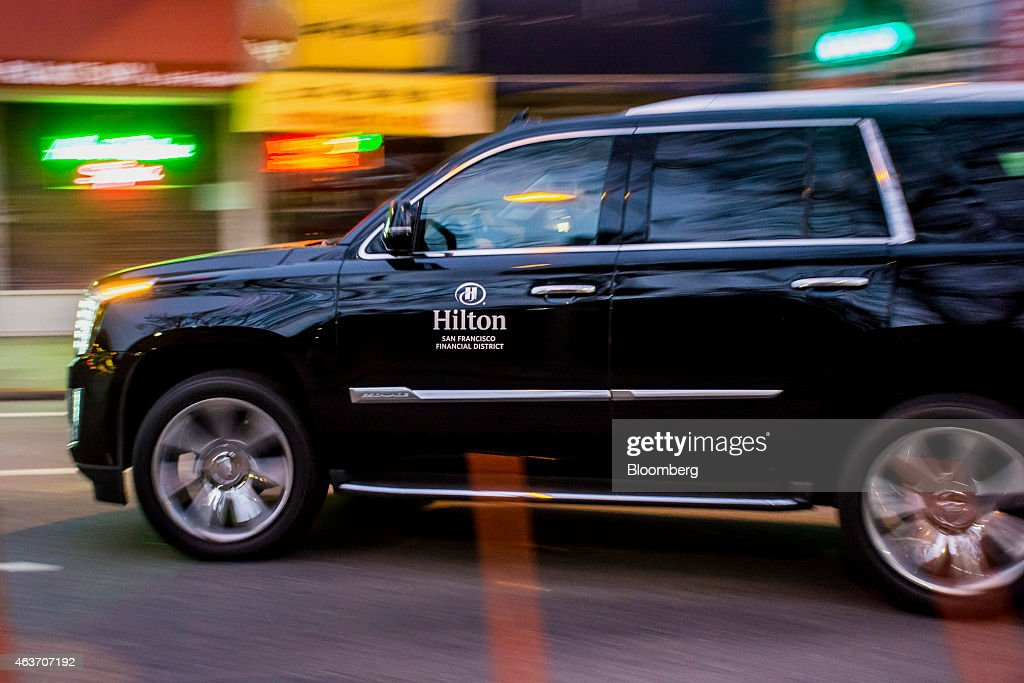 a vehicle with the hilton worldwide holdings inc logo arrives at one of the companys - Compact Hotel 2015