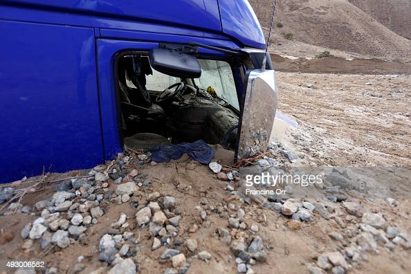 A vehicles affected by the mudslide is seen October 16 2015 in Telachapi California After a heavy rain yesterday the highway was inundated by...