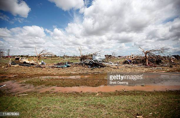 Vehicles and boats are wrecked in the rural neighborhood struck by a tornado May 25 2011 in Piedmont Oklahoma The state medical examiner's office...