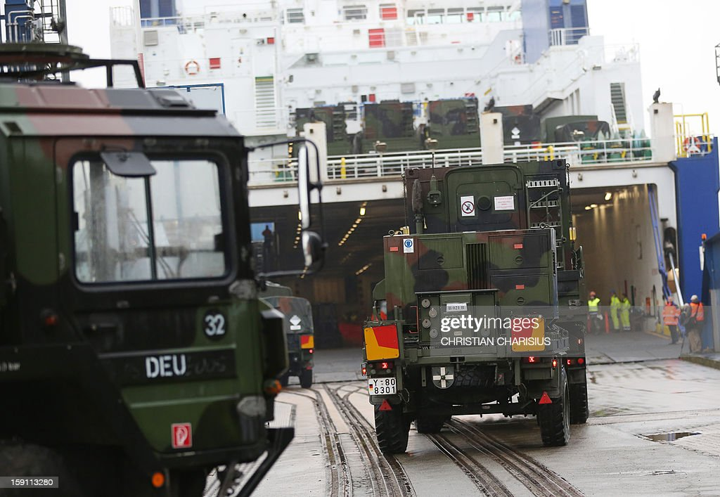 Vehicles and containers of the German Army division 'Patriot' are loaded onto the ferry boat «Suecia Seaways in the port of Lubeck-Travemunde in northern Germany on January 8, 2013 as part of a NATO mission. Germany deploys Patriot missiles to help Turkey defend its border against conflict-riven Syria as part of a NATO mission. The German Patriot missile batteries will be positioned about 120 kilometres (75 miles) from the Syrian border in southern Turkey with a mandate that will run until January 31, 2014.