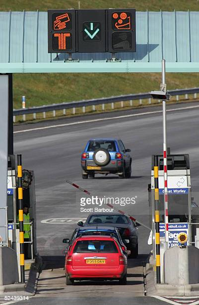 Vehicles aproach the M6 motorway toll booths on March 13 2005 in Birmingham England The number of vehicles using the Toll road which opened in...