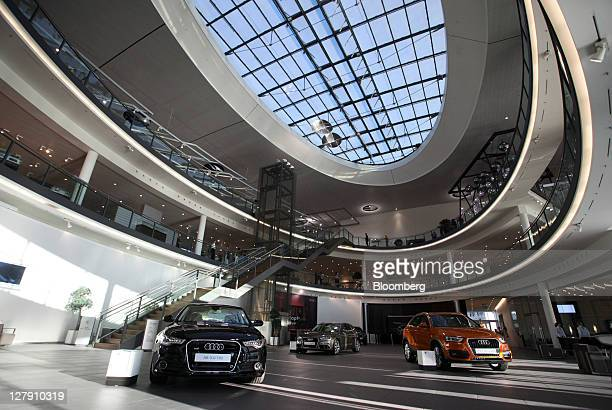 Vehicles are displayed in the Audi showroom or 'forum' at the company's factory in Neckarsulm Germany on Friday Sept 30 2011 Volkswagen AG's Audi...