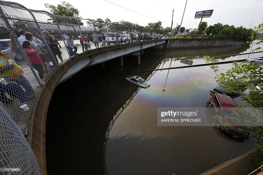 Vehicles are left stranded on a flooded Interstate 45 in Houston Texas on May 26 2015 Heavy rains throught Texas put the city of Houston under...