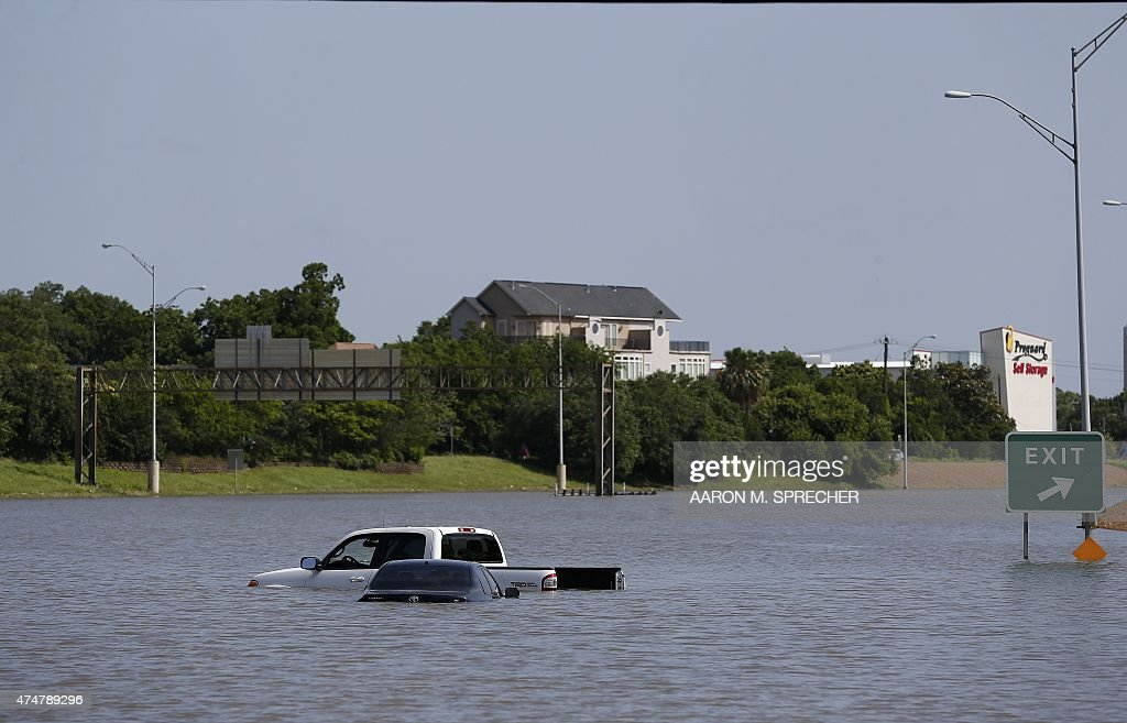 Vehicles are left stranded on Texas State Highway 288 in Houston Texas on May 26 2015 Heavy rains throught Texas put the city of Houston under...