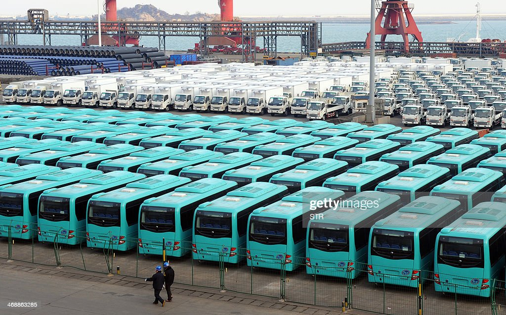 Vehicles are lined up ready to be loaded onto a ship at the port in Lianyungang, east China's Jiangsu province on February 12, 2014. China's trade surplus rose 14.0 percent year-on-year in January to 31.86 billion USD, official figures showed as exports increased 10.6 percent to 207.13 billion USD, while imports were up 10.0 percent to 175.27 billion USD, the General Administration of Customs said. CHINA
