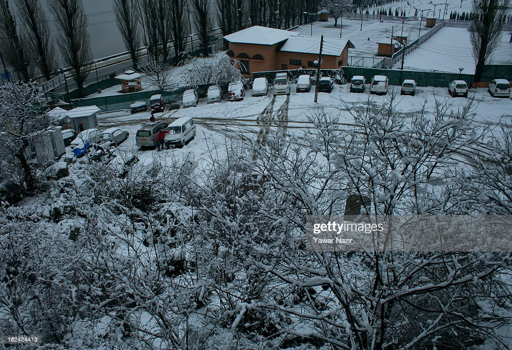 Vehicles are parked after a snowfall on February 23, 2013 in Srinagar, Indian Administered Kashmir, India. Several parts of the Kashmir Valley, including the summer capital Srinagar, experienced fresh snowfall today, prompting the authorities to issue an avalanche warning and leading to closure of the Jammu-Srinagar Highway, the only road link between Kashmir and rest of India.