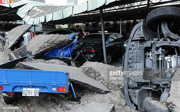 Vehicles are seen at the site of gas explosions in the southern Taiwan city of Kaohsiung on August 1 2014 A series of powerful gas blasts killed at...