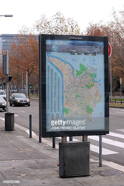 Vehicles are seen next to a billboard on November 25 in Grenoble a few days after the mayor of Grenoble announced the ban of commercial street...