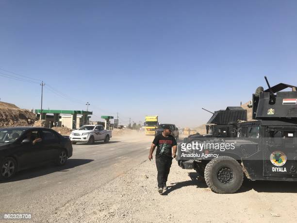 Vehicles are seen on their way back to Kirkuk after Iraqi forces retake the control of the city center from Peshmerga forces in Kirkuk Iraq on...