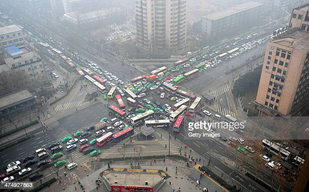 Vehicles are stuck in a traffic jam in heavy smog after the traffic lights were brokendown on February 25 2014 in Xi an China Altogether 143 million...
