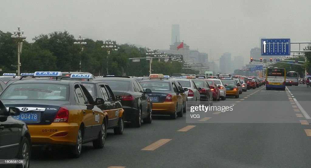 Vehicles are stuck in a traffic jam on Chang'an Avenue on September 16, 2013 in Beijing, China. Beijing is experiencing severe congestion due to more traffic before the Mid-Autumn Festival, which falls on September 19 this year.