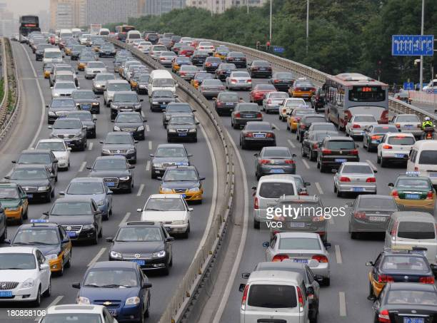 Vehicles are stuck in a traffic jam on the 2nd ring road on September 16 2013 in Beijing China Beijing is experiencing severe congestion due to more...