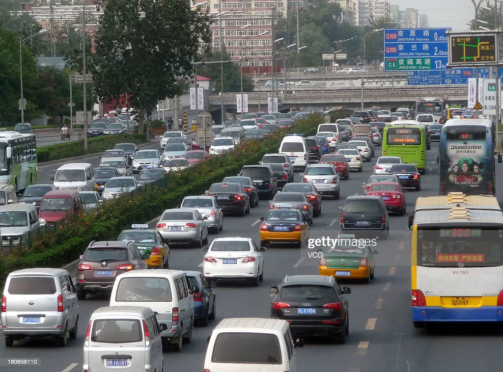 Vehicles are stuck in a traffic jam on the 3rd ring road on September 16, 2013 in Beijing, China. Beijing is experiencing severe congestion due to more traffic before the Mid-Autumn Festival, which falls on September 19 this year.