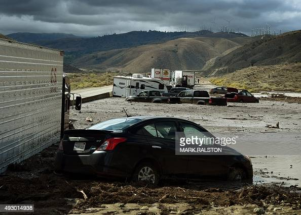 Vehicles are stuck on a road after being trapped by a mudslide on California Highway 58 in Mojave California on October 16 after torrential rains...