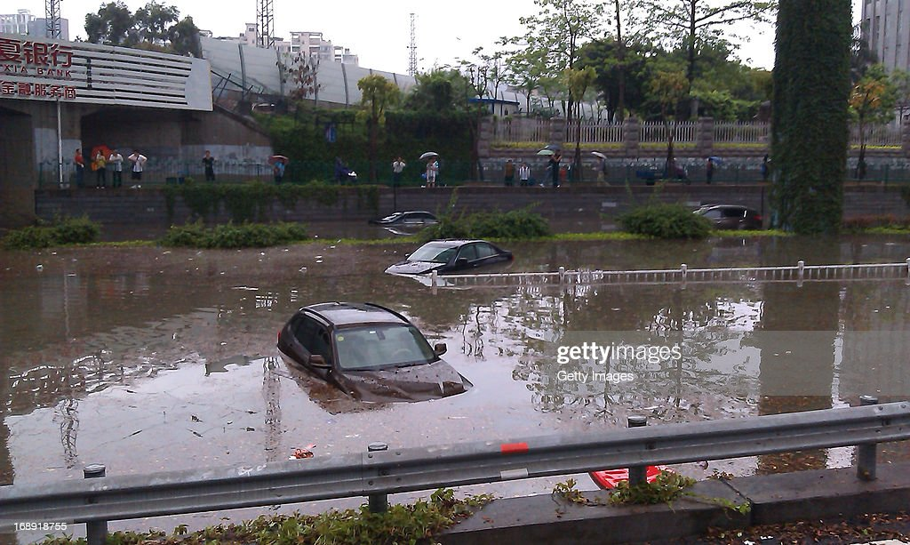 Vehicles are trapped in a flooded street on May 16, 2013 in Xiamen, China. A round of rainstorms hit South China since Tuesday, leaving 33 people dead and 12 missing.