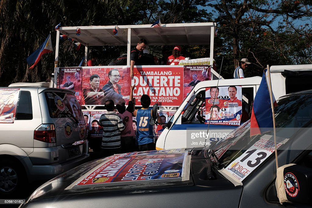 Vehicles covered in banners prepare for a campaign event by presidential candidate Rodrigo Duterte on May 1, 2016 in Manila, Philippines. Duterte, the tough-talking mayor of Davao in Mindanao has been the surprise pre-election poll favorite, pulling away from his rivals despite controversial speeches and little national government experience. Opinion polls have shown Mr. Duterte has maintained his lead with 33 percent support, with Senator Grace receiving 22 percent. The Philippine presidential elections will be held on May 9, with five candidates vying for the top post.