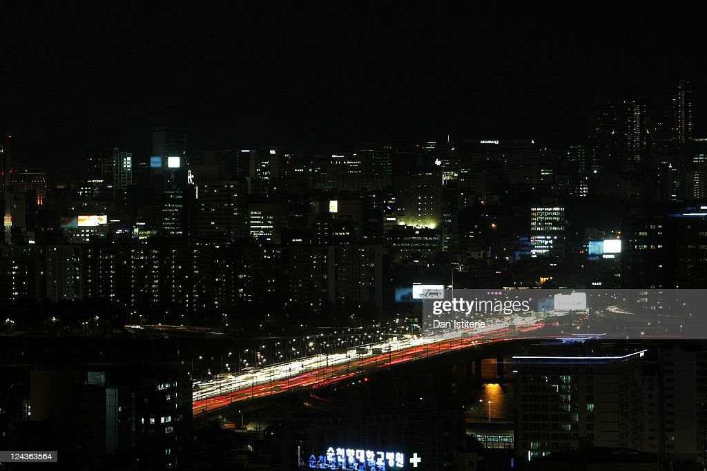 Vehicles cross a bridge over the Han River at night backdropped by skyscrapers in the Gangnam business district on September 5, 2011 in Seoul, South Korea. The South Korean capital has a population in excess of 10 million with the wider metropolitan area being home to more than 20 million making it one of the largest in the world.