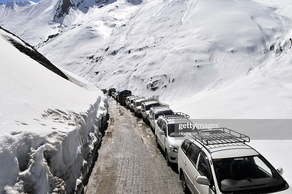 Vehicles cross through a snow bound Zojila pass, 108 kilometers (67 miles) east of Srinagar, on April 30, 2016 in Srinagar, India. The Srinagar-Leh road link was thrown open for vehicular traffic after around five months. India's Border Roads Organisation (BRO) which maintains the road opened it after clearing the snow from Zojila Pass, 3630 meters above sea level. The 434-km Srinagar-Leh National Highway, the only road linking Kashmir with frontier region of Ladakh, has been partially thrown open to vehicular traffic after remaining closed for over six months owing to heavy snowfall during winter. The Pass attracts the heaviest snowfall during the winter and as such it remains closed to traffic for five to six months in a year.