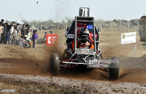 Vehicles cross through mud during the Grand Finale of Baja SAEIndia 2014 event held at Pithampur on February 23 2014 near Indore India Baja SAEIndia...